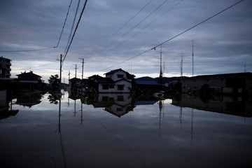 Submerged houses are seen in a flooded area in Mabi town in Kurashiki