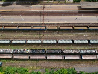 Fotobehang Treinstation Cargo wagons on train station in city, aerial view