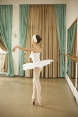 Little ballerina in ballet studio