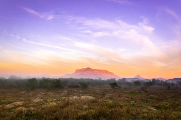 View of Table Mountain at sunrise on a misty morning , Cape Town, South Africa