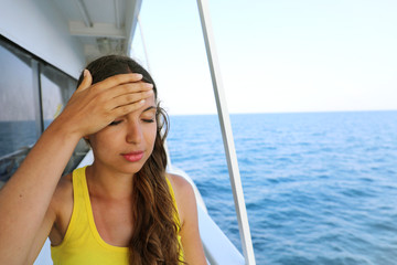 Young woman suffer from seasickness during vacation on boat. Cruise sea motion sickness tourist woman on boat vacation with headache or nausea. Fear of travel or illness virus on cruising holiday.