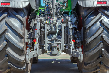 Tractor for farm work, modern agricultural transport working in the field, modern tractor close-up