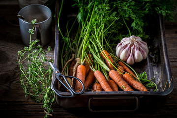 Ingredients for roasted vegetables made of garlic and carrots