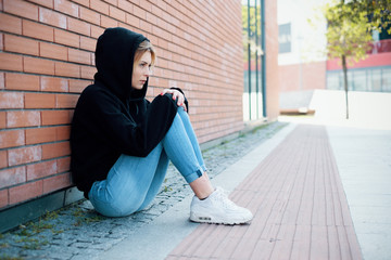 Young girl portrait outdoor feeling alone and sad