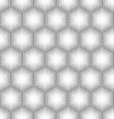 Seamless halftone vector background.Filled with black circles .
