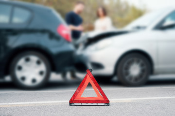 People checking car damages after car accident, roadside service concept
