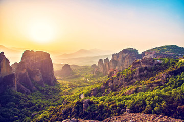 magnificent magical landscape in the famous valley of the Meteora rocks in Greece at susnet. Great amazing world. Attractions.