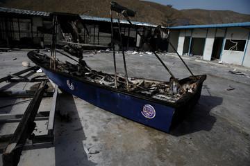 A burnt boat is seen inside the customs facilities in Malpasse