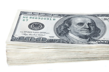 A bundle of ten thousand American dollars in bills of one hundred dollars. On a white background. Isolated.