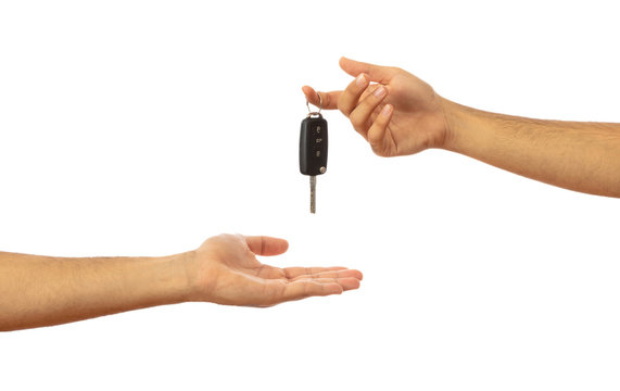 Handing over the car key. Hands isolated on white background, clipping path