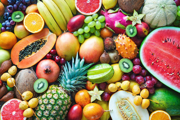 Spoed Fotobehang Vruchten Assortment of colorful ripe tropical fruits. Top view