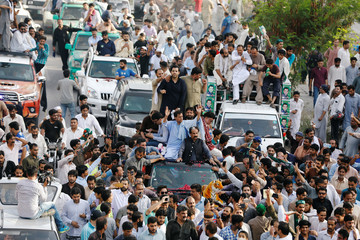Muhammad Safdar, son–in-law of ousted Prime Minister Nawaz Sharif, waves to supporters while leading a rally before his arrest in Rawalpindi