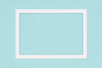 Abstract flat lay pastel blue colored paper texture minimalism background. Minimal template with empty picture frame mock up.