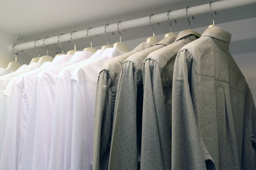 Light and dark shirts in the closet on the hanger