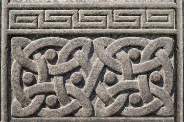 Old stone carved Celtic design symbol, Celtic knot