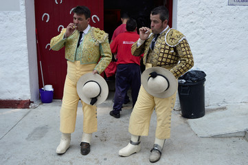 Picadores smoke before a bullfight at the San Fermin festival in Pamplona