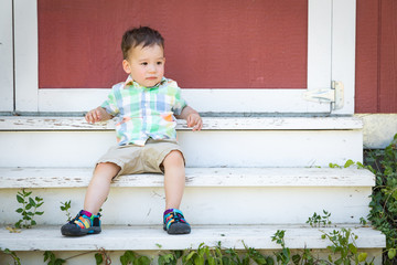 Young Mixed Race Chinese and Caucasian Boy Relaxing On The Steps