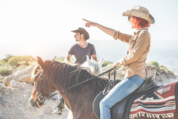 Couple riding horses in countryside on excursion nature tour