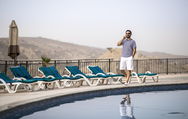 middle aged arab man by a pool