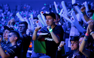Fans of Electronic Sports (E-Sports) react as they watch the final of the ESL One Cologne Counter-Strike tournament at the Lanxess Arena in Cologne