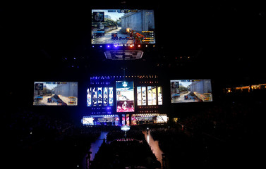 Counter-Strike characters are seen on video screens as fans of Electronic Sports (E-Sports) watch the final of the ESL One Cologne Counter-Strike tournament at the Lanxess Arena in Cologne