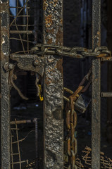 Old rusted padlock on gates