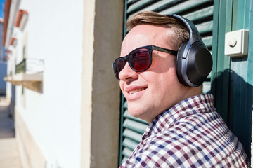 Young man enjoying the music in the urban settings