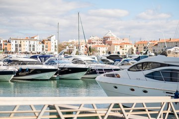 Marina with luxurious yachts and sailboats in touristic Vilamoura, Algarve, Portugal