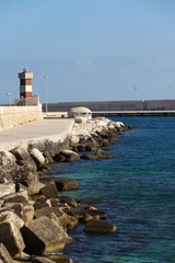 Lighthouse in Monopoli port in front of Castle of Carlo V, Adriatic Sea, Apulia, Bari province, Italy