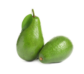 Ripe fresh avocados on white background