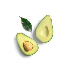 Ripe sliced avocado on white background