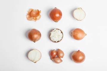 Beautiful composition with ripe onions on white background