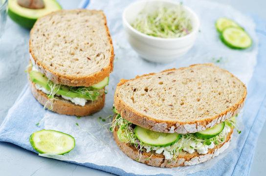 Ricotta sprouts avocado cucumber rye sandwich