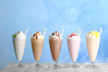 Aluminium Prints Milkshake Glasses with delicious milk shakes on table