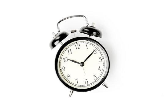 Black alarm clock  on white background.
