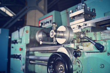 Lathe, metal processing by cutting on industrial equipment. Tinted image.