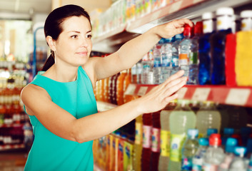 Woman want to buying bottle with water