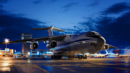 Large Russian cargo plane IL-76 close-up of the night in the airport Yekaterinburg.