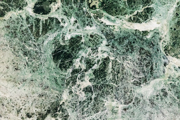 Marble green emerald background, beautiful stains and patterns