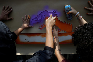"Demonstrators hold a protest called ""Dinosaurs, goodbye. Don't come back"" outside the Institutional Revolutionary Party (PRI) headquarters, in Mexico City"