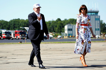 U.S. President Donald Trump and U.S. first lady Melania Trump walk from Marine One as they depart from Morristown, New Jersey