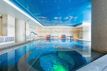 Indoor swimming pool in hotel spa center