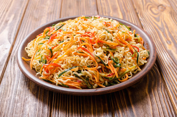 Asian noodles salad in bowl