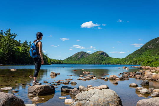 Hiker enjoying the view at Jordan Pond in Acadia National Park