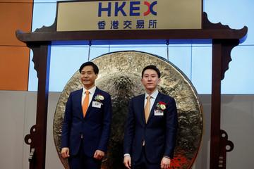 Xiaomi founder Lei Jun and CFO Shou Zi Chew attend listing of the company at Hong Kong Exchanges in Hong Kong