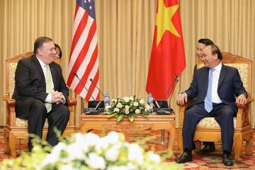 U.S. Secretary of State Pompeo smiles as he meets Vietnam's PM Nguyen Xuan Phuc in Hanoi