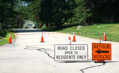 road blocked and detour sign in residential area