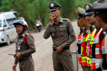 Police officers block to rod of  Tham Luang cave complex  in the northern province of Chiang Rai