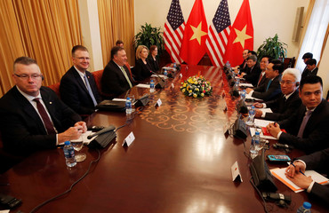 U.S. Secretary of State Mike Pompeo and Vietnam's Deputy Prime Minister and Foreign Minister Pham Binh Minh talk in Hanoi