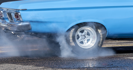 Drag racing car burning rubber